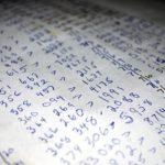 手書きで紙に書かれた集計表